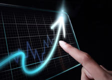 Finger pointing at growth chart on tablet Stock Photography