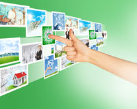 Finger pointing at holographic pictures Royalty Free Stock Photos