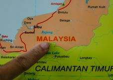 Finger pointing on the Malaysia map. A finger pointing on the Malaysia map. Close up royalty free stock images