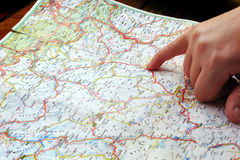 Finger pointing navigation travel map Royalty Free Stock Photos
