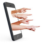 Finger pointing out of smartphone. Many fingers pointing out of the display from a smartphone Stock Images