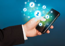 Finger pointing on smartphone, social network concept Royalty Free Stock Photo