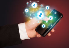 Finger pointing on smartphone, social network concept Royalty Free Stock Photos