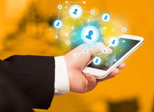 Finger pointing on smartphone, social network concept. Finger pointing on smartphone with social network illustration Stock Photography