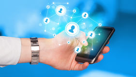 Finger pointing on smartphone, social network concept Royalty Free Stock Images