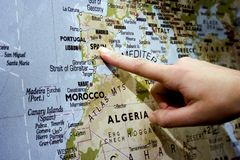 Finger pointing Spain. Finger pointing a destination at the Europe map (Spain). Landscape orientation Stock Photo
