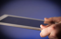 Finger pointing on tablet pc with empty space Royalty Free Stock Images