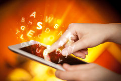 Finger pointing on tablet pc, letters concept Royalty Free Stock Image