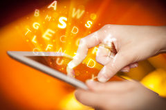 Finger pointing on tablet pc, letters concept Royalty Free Stock Photos