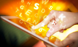Finger pointing on tablet pc, letters concept Royalty Free Stock Photo
