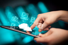 Finger pointing on tablet pc, mobile cloud concept Stock Image