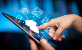 Finger pointing on tablet pc, mobile cloud concept Stock Photo