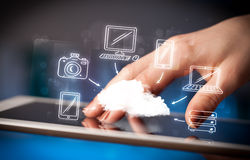 Finger pointing on tablet pc, mobile cloud concept Royalty Free Stock Photography