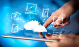 Finger pointing on tablet pc, mobile cloud concept. Hand touching tablet pc, mobile cloud concept Royalty Free Stock Images