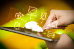 Finger pointing on tablet pc, mobile cloud concept. Hand touching tablet pc, mobile cloud concept Stock Photos