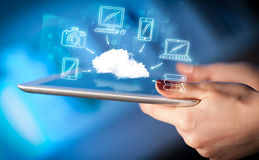 Finger pointing on tablet pc, mobile cloud concept Stock Photos
