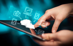 Finger pointing on tablet pc, mobile cloud concept Stock Photography