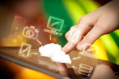 Finger pointing on tablet pc, mobile cloud concept Royalty Free Stock Photo
