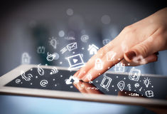 Finger pointing on tablet pc, social media concept Stock Image