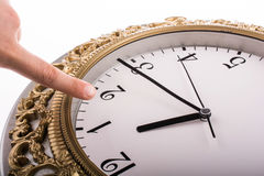 Finger pointing to a  clock and mechanism. Finger pointing to clock and mechanism Stock Photos