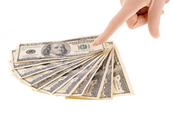 Finger pointing to dollars Royalty Free Stock Image