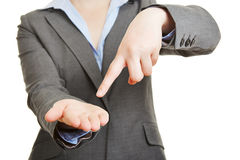Finger pointing to empty palm of hand Royalty Free Stock Photo