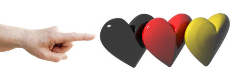 Finger pointing to german flag made of hearts Royalty Free Stock Photography