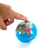 Finger pointing to the globe Royalty Free Stock Photography