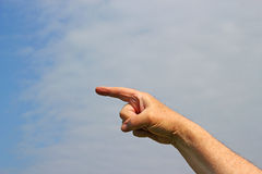 Finger pointing to the left. Royalty Free Stock Photo