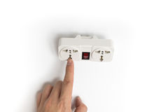 Finger pointing to power plug socket Stock Images