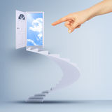 Finger pointing to spiral stairs and magic doors. Leading to a cloudscape Stock Photography
