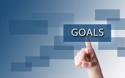 A finger pointing the word goals Stock Image