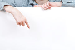 Finger points on blank billboard Royalty Free Stock Photo