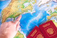 Finger points to a destination on the map stock photos