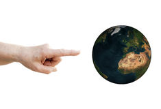 Finger points to planet Earth Royalty Free Stock Images