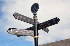 Finger post at Haltwhistle. A finger signpost in the town of Haltwhistle, which is at the geographical centre of Britain Royalty Free Stock Photo