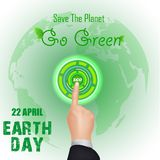 Finger press eco button on globe. Earth day concept Stock Images