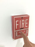 Finger press on fire alarm unit royalty free stock image