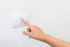 Finger press on light button. Modern Finger press on light button Stock Images