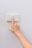 Finger press turn on/off electric-switch Stock Photography