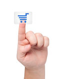 Finger presses button with icon cart. Stock Photos