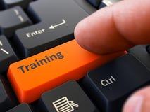 Finger Presses Orange Keyboard Button Training. Finger Presses Orange Button  Training on Black Keyboard Background. Closeup View. Selective Focus Stock Photos