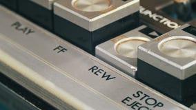 Finger Presses Rewind Control Buttons on Audio Cassette Player