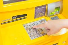 Finger pressing ATM Stock Image