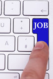 Finger pressing on blue job button. Finger pressing on blue apply now button. Job oportunity Royalty Free Stock Image