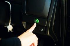 Finger pressing button econ mode Stock Image
