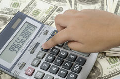 Finger pressing on a calculator to calculate the financial report. stock photos