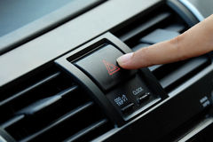 Finger pressing car emergency button.  royalty free stock image