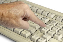Finger pressing on delete button. Royalty Free Stock Photo