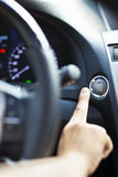 Finger pressing the Engine start stop button Stock Photos
